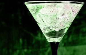 A cocktail glass with absinthe