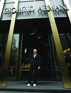 Giorgio Armani infront of one of his flagship stores